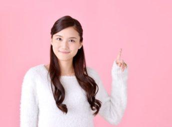 指さす女性6